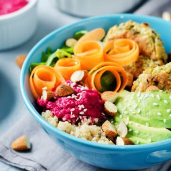 Quinoa Beet Hummus Falafel Bowl on a stone background. toning. selective focus; Shutterstock ID 785281864